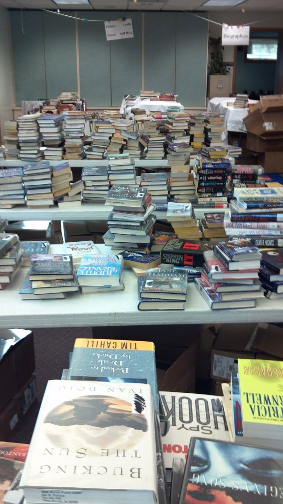 Before the sale begins, mounds of books lie on the tables.